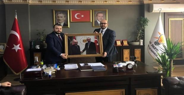 ARNAVUTKÖY  MHP'DEN  AK PARTİ'YE  İADEİ ZİYARET